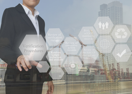 Businesswoman with presentation element of Verification Procedures concept for use in manufacturing, training and company system.