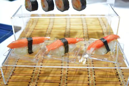Nigiri Sushi on plastic plate background.
