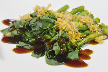 Top view food, Kale with oyster sauce and fried garlic on white background Banco de Imagens