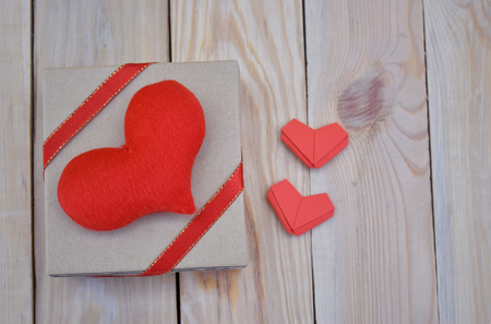 Red couple paper hearts shape and gift box on wooden background. Concept for in Love,  Valentines Day, Birthday or Wedding.