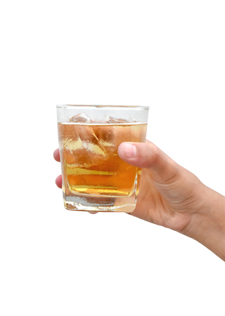Hand woman holding cold glass of beer with ice on white background