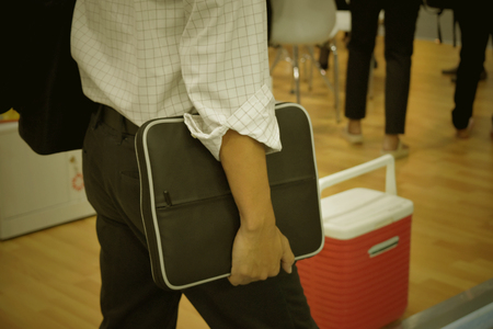 businessman holding briefcase going to the office. concept in business and working. Banco de Imagens