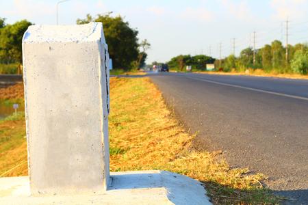 milestone near the road isolated