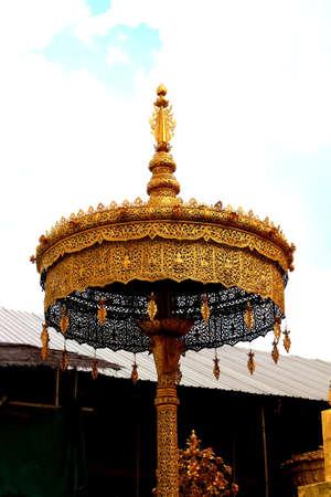 tiered: golden tiered umbrella Stock Photo