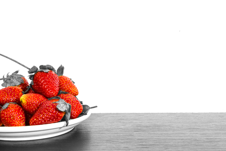 white wood floor: strawberries on wood floor and white isolated