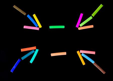 chalks: colorful chalks make arrow black background Stock Photo