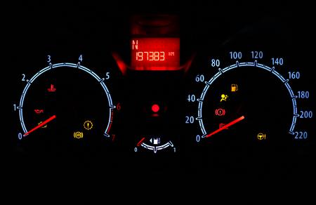 odometer inside car in night time dark background