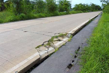 earthquake crack: road crack damage danger for people have accident Stock Photo