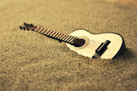 country music: spanish guitar in the sand