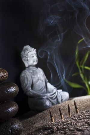 frankincense: stone sitting buddha and frankincense