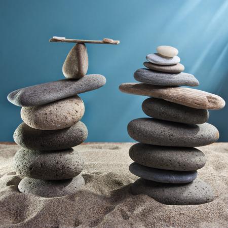 equilibrium: equilibrium tower stones blue background Stock Photo