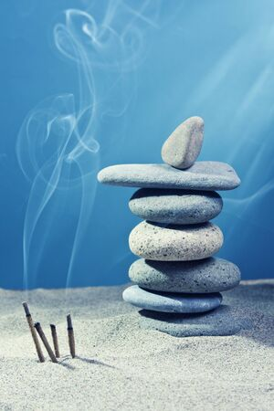 equalize: tower of stones and frankincense in the sand