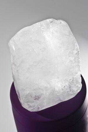 ecologic: one ecologic deodorant crystal in black-ground grey Stock Photo