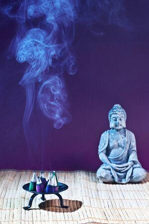 frankincense: stone sitting buddha and frankincense