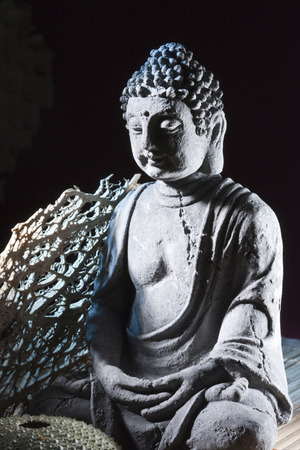 nebulous: stone sitting buddha  black background