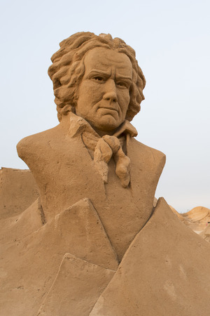 beethoven: ALGARVE, PORTUGAL - August 6, 2015:  Ludwig van Beethoven sand sculpture of unidentified artist at FIESA, International Sand Sculpture Festival in Algarve, Portugal.
