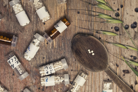 globules: bottles with homeopathy globules and spoon Editorial