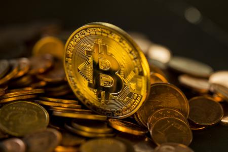 Bitcoin. Cryptocurrency . Gold coin bitcoin on a golden shiny background. virtual money concept