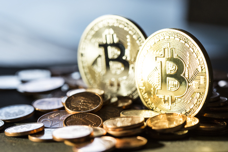 Golden Bitcoin virtual currency coin on a money Zdjęcie Seryjne