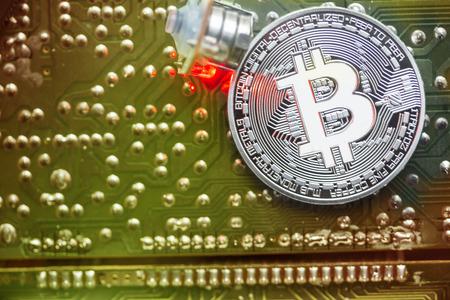 silver bitcoin in circuit board