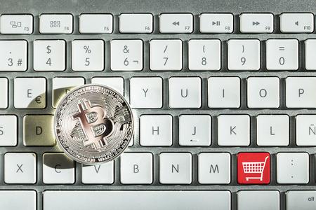 silver bitcoin in keyboard