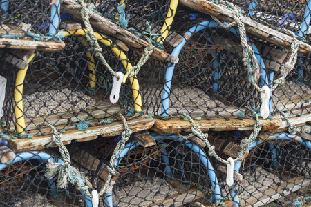 Fishing traps, lobster pots at harbor