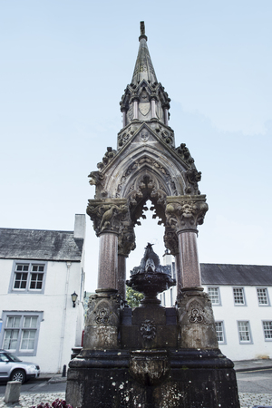 Atholl Memorial Fountain and the Historic Ell Shop on the High Street in Dunkeld. A town in Perthshire, Dunkeld is known as the Gateway to the Highlands.
