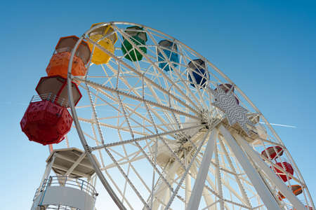 Colorful ferris wheel in a theme park