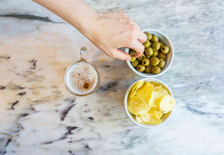 Classic appetizer with beer, chips and olives