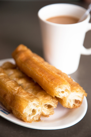 Chinese doughnut or You Tiao with milky tea photo