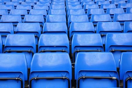 baseball stadium: Blue seats in row on stadium