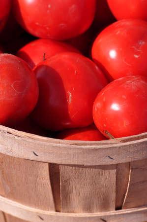 tomatos: Tomatos in a basket Stock Photo