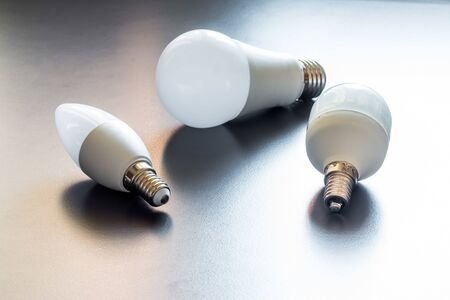 White light bulb lying on a desk, concept for ideas 免版税图像