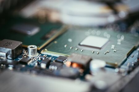 Computer chip on a circuit board, close up; Computer technology.