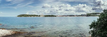 Beautiful bay near Rovinj, clear water and stony beach, Croatia