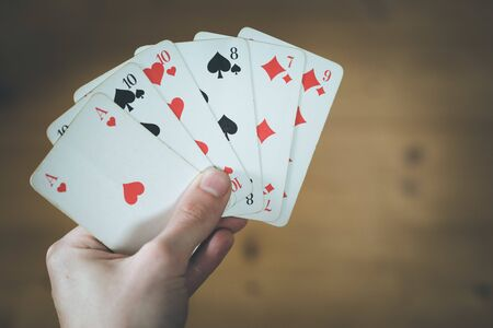 Man is playing cards, cutout of his hands