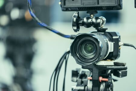 Film camera on a tripod in a television studio 스톡 콘텐츠