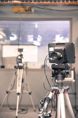 Film camera on a tripod in a television broadcasting studio 스톡 콘텐츠