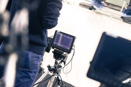 Male cameraman is operating a film camera in a television studio 스톡 콘텐츠