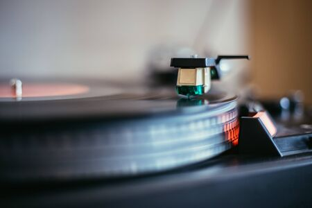 Close up picture of a record player, playing a record Banco de Imagens