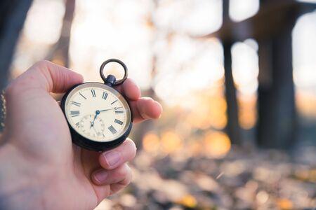 Hand held stop watch outdoors, autumn, blurry background Banco de Imagens