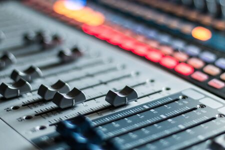 Professional music production in a sound recording studio, mixer desk