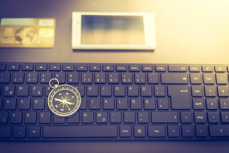 Web business: Arrangement of keyboard, compass, credit card and smartphone
