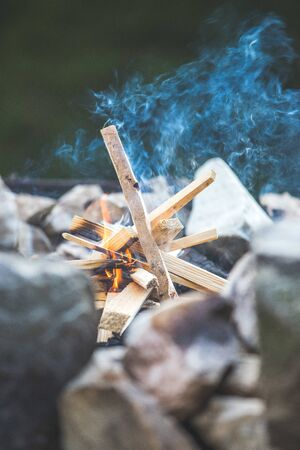 Making fire in the wood, camping outdoors