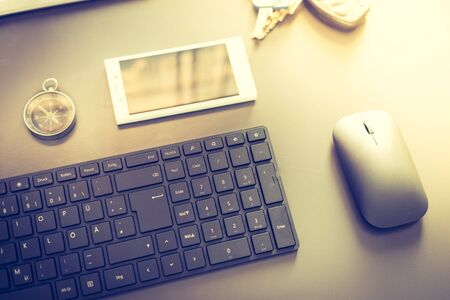Web business: Arrangement of keyboard, compass and smartphone