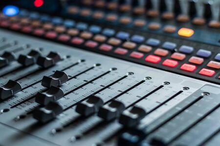Professional music production in a sound recording studio, mixer desk