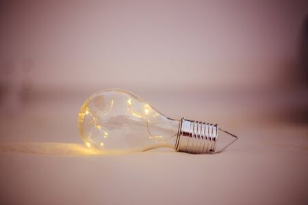 LED light bulb is lying in the bed. Symbol for ideas and innovation.