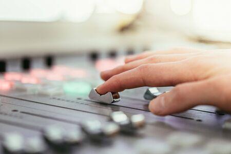 Moderator and soundboard in radio broadcasting studio Foto de archivo