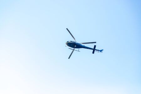 Close up of flying helicopter on blue sky