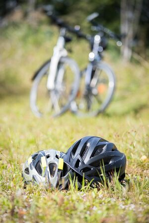 Bike helmets in the grass, bike tour Stock fotó